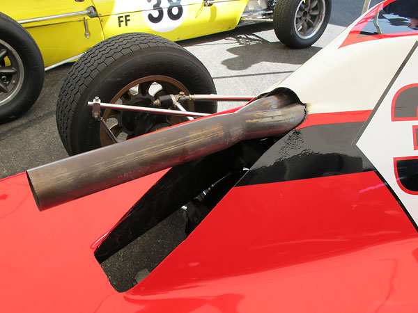 Normally the exhaust on a Crossle 35F comes through the bodywork on the lefthand side.