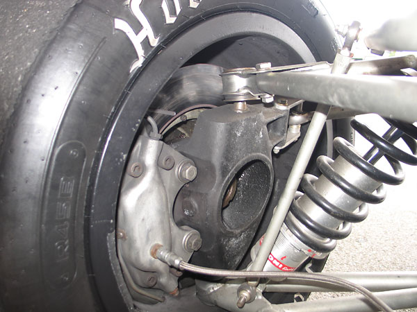 Magnesium uprights and Girling disc brakes carry over from T190.