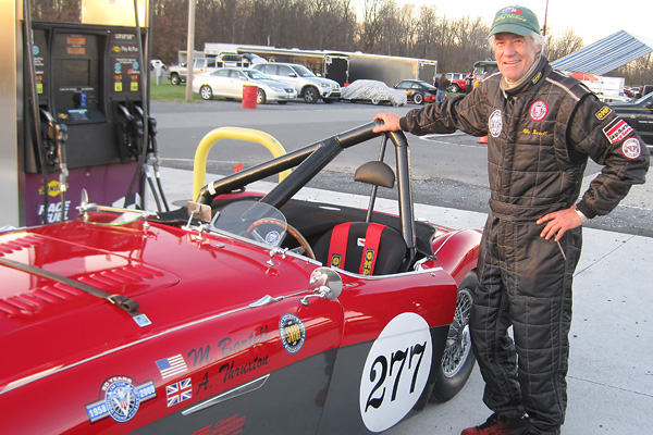 Mike Bartell standing next to his 1956 Austin Healey 100M racecar.