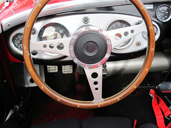 Tourist Trophy 15 inch laminated wood rim steering wheel with drilled holes and satin finish.