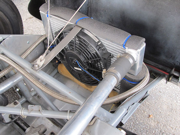 Custom aluminum crossflow radiator and electric cooling fan.