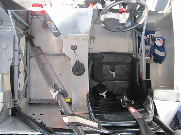 The driver's side footbox extends right up beside the engine.