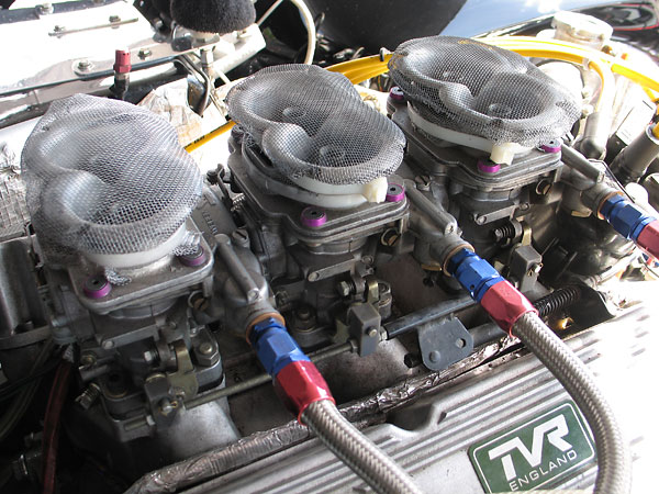 Triple Weber 44 DCNF carburetors.