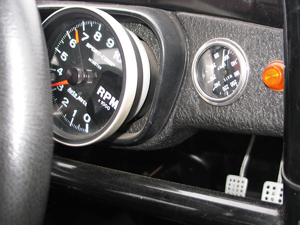 AutoMeter SportComp Monster tachometer (0-10000rpm) and Stewart Warner coolant temperature gauge (100-280F).