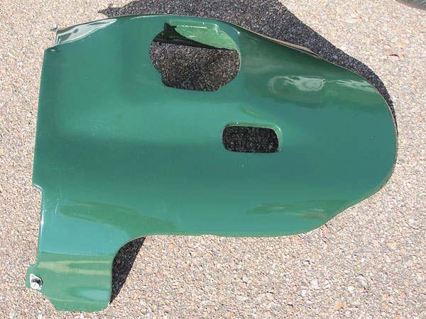 Fiberglass engine cover.