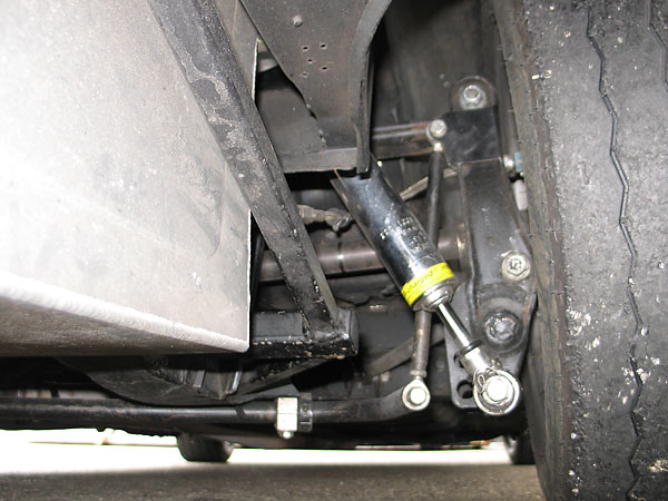 Z-bar reduces the swing axle's inherent tendency towards jacking.