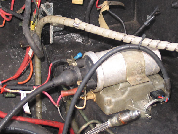 The ignition coil is sitting on top of a Lucas electronic ignition amplifier.