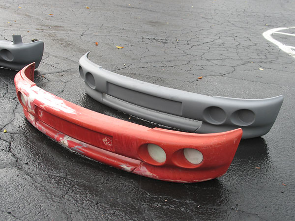 An original (slightly damaged) MG RV8 front bumper, and a fiberglass replica made from it.
