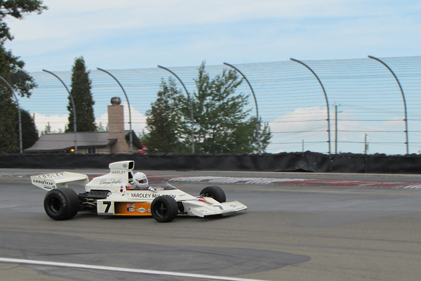 Denny Hulme's McLaren M23 returned to race at Watkins Glen in 2011