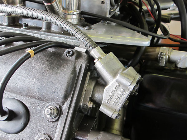 A high pressure mechanical fuel pump is driven via cable from one of the four camshafts.