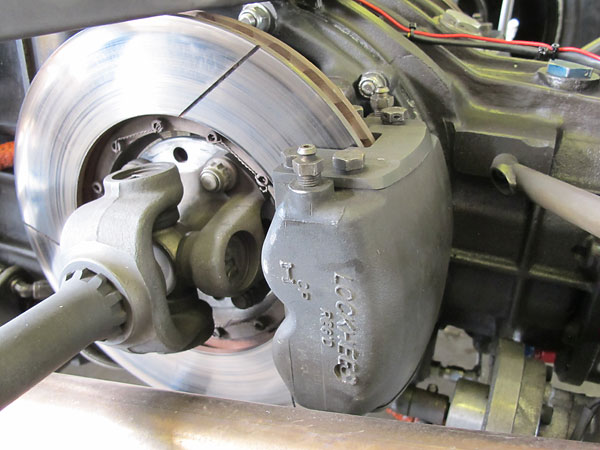 Lockheed four-piston brake caliper with 10.5 inch vented rotors, inboard-mounted.