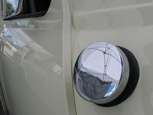 Polished stainless steel fuel filler cap.