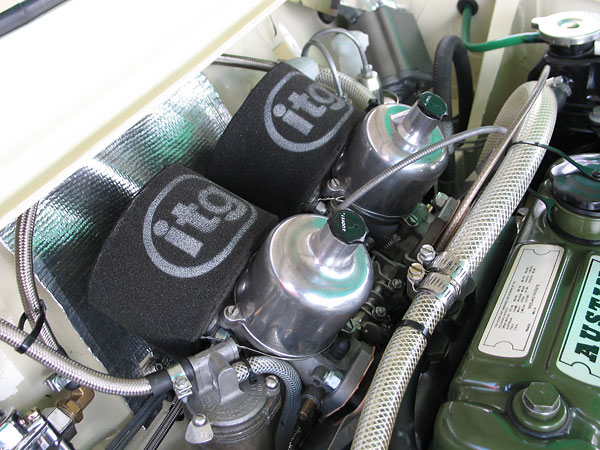 Dual S.U. HS4 (AUD 135F and AUD 135R) carburetors. ITG foam air filters.