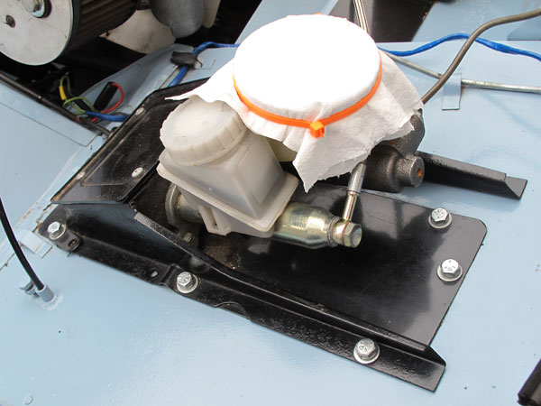 Later model Spridget master cylinder has separate front and rear circuits for safety.