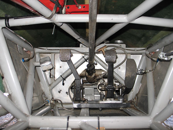 The complete pedal and master cylinder assembly is mounted on a sled.