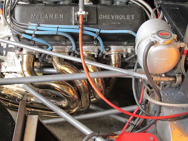 The McLaren team used stainless steel headers. Trojan-produced M8Fs came with mild steel headers.