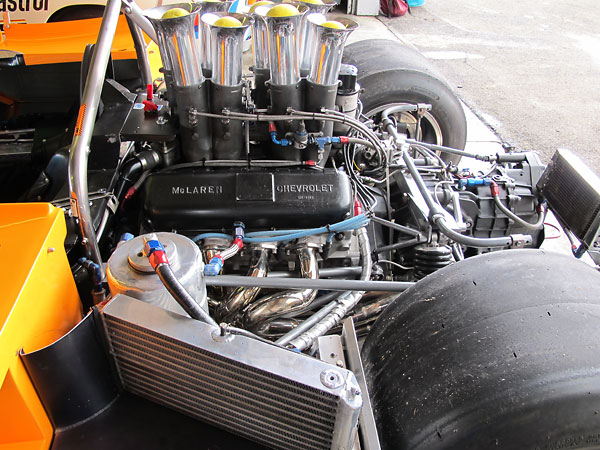 A large NACA duct on the passenger side of the body directs air into a single engine oil cooler.