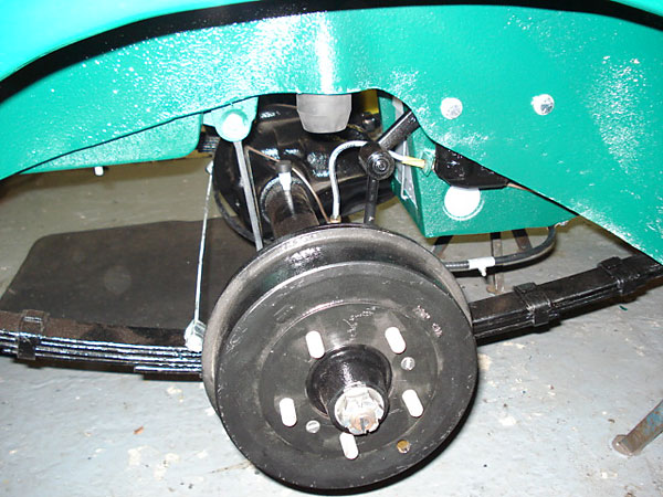 Stock drum brakes. Note: MGC featured five-lug wheels.
