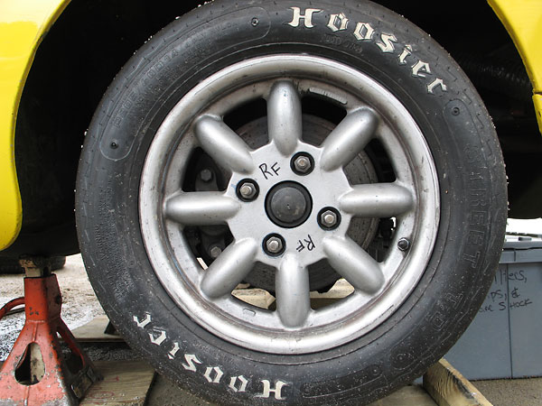 Compomotive 14x6 aluminum wheels with Hoosier Street T.D. P205/60D14 bias ply tires.