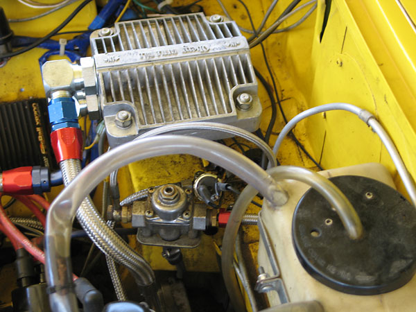 Oberg Tattle Tale oil filter. (Foreground: fuel pressure regulator.)