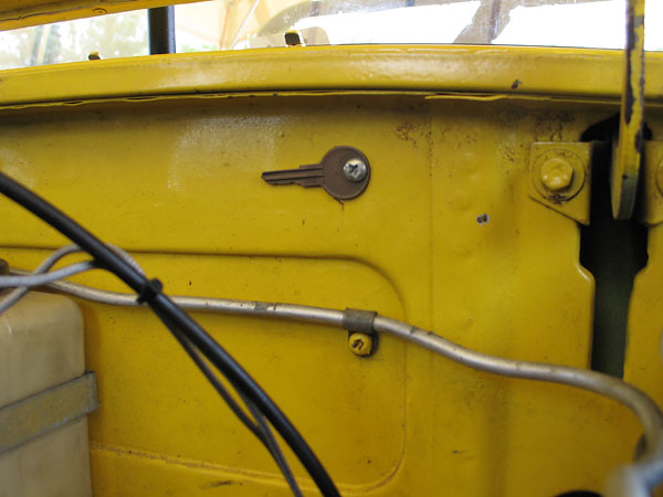 MGB's left the factory with a spare key screwed to their firewall. This one is still in place.