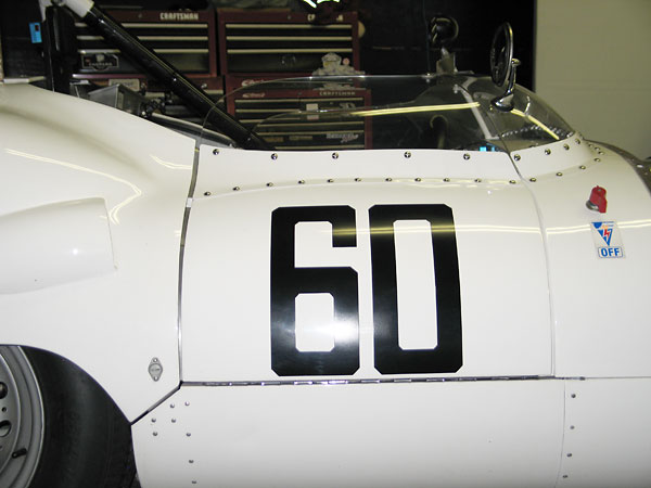 Wrap-around Perspex (acrylic) windscreens became a common feature of sports racing cars of this era.