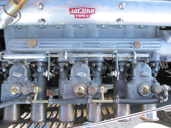 Warneford Design intake manifold supports triple Weber 45DCOE carburetors.