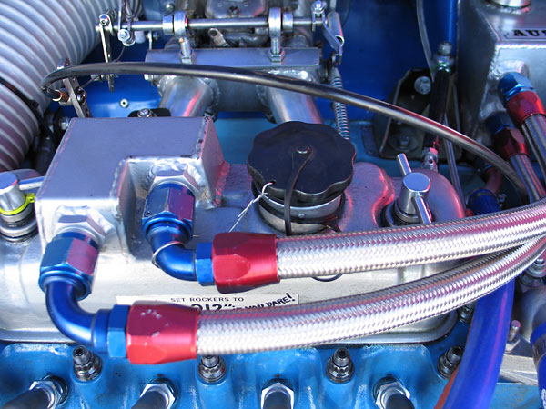 Valve cover modified for vent plumbing.