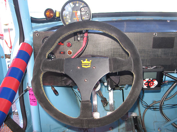 Personal suede covered ergonomic steering wheel.
