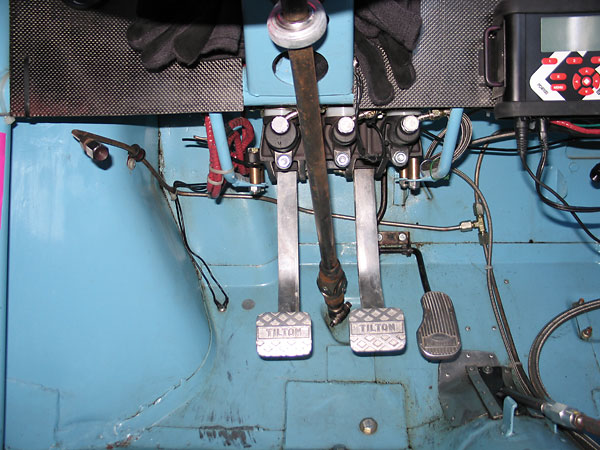 Tilton pedal assembly with dual Tilton master cylinders. Paddy Hopkirk throttle pedal pad.