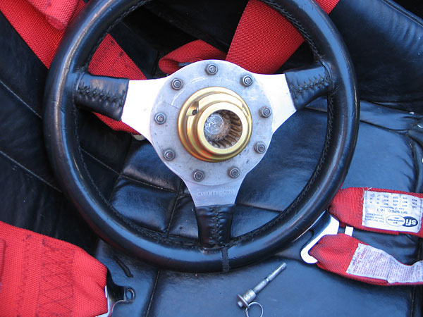 A pip pin secures the quick release steering wheel hub.