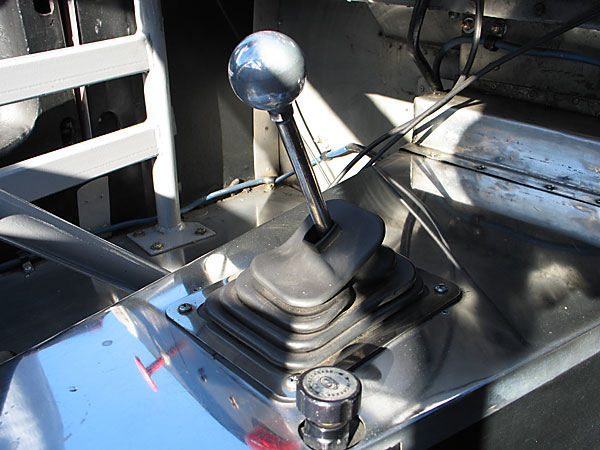 An adjustable brake proportioning valve remains where it was installed for SCCA racing.